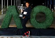 FILE PHOTO - Tennis - Australian Open - Melbourne Park, Melbourne, Australia - early 29/1/17 Serena Williams of the U.S. poses with the Women's singles trophy after winning her final match. REUTERS/Thomas Peter/Files