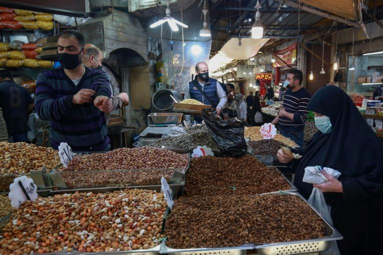 People shop in Jordan's capital Amman on April 5; Jordanians say a reporting blackout on matters of the royal family mean they hear little news on the matter