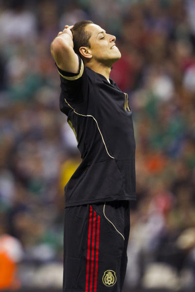 Mexico's Javier Hernandez reacts after missing a chance to score against the United States during a 2014 World Cup qualifying match at the Aztec stadium in Mexico City, Tuesday, March 26, 2013. (AP Photo/Christian Palma)