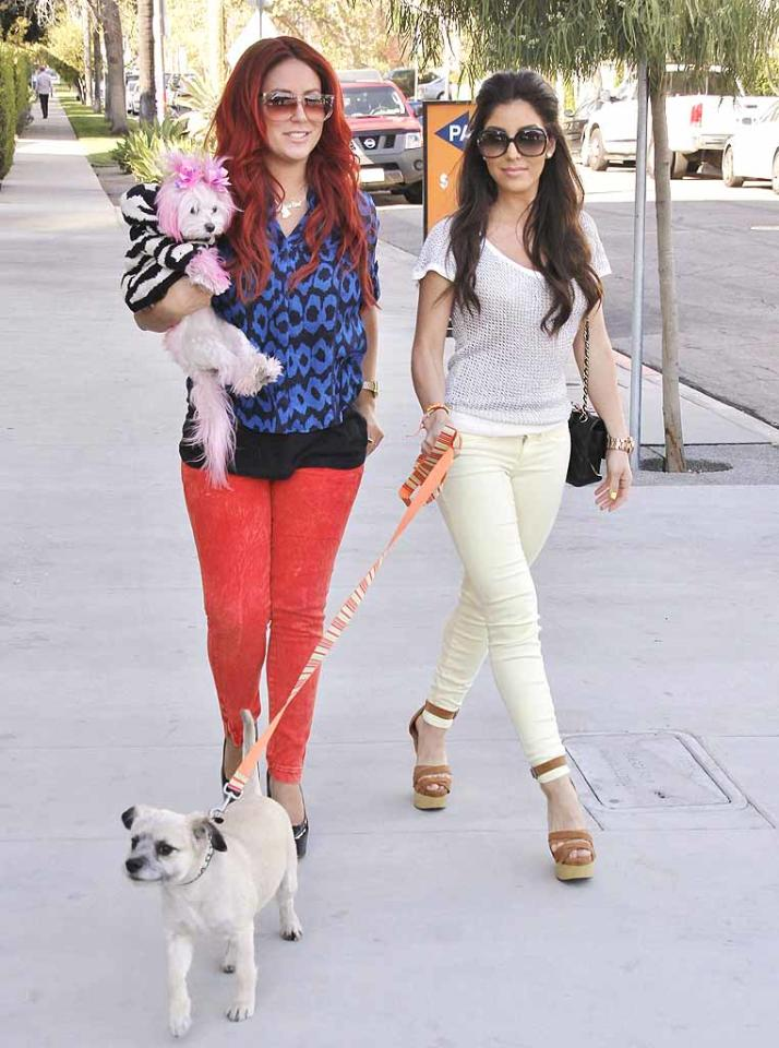Aubrey O'Day was spotted out and about in L.A. on Thursday with her colorful dogs and her pal, Melissa Molinaro.  (3/8/2012)