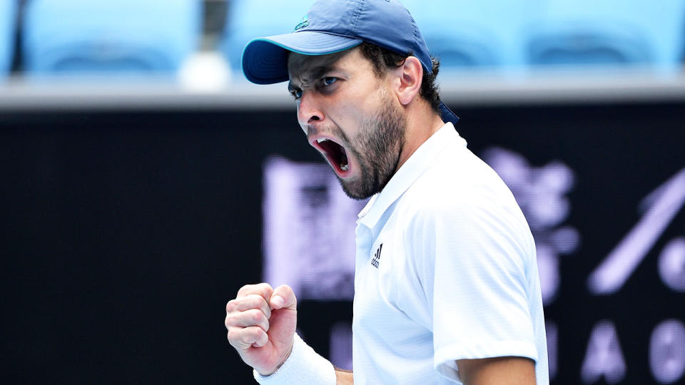 Russia's Aslan Karatsev pulled off a five-set upset against Felix Auger-Aliassime to qualify for the Australian Open quarter-finals. (Photo by PAUL CROCK/AFP via Getty Images)