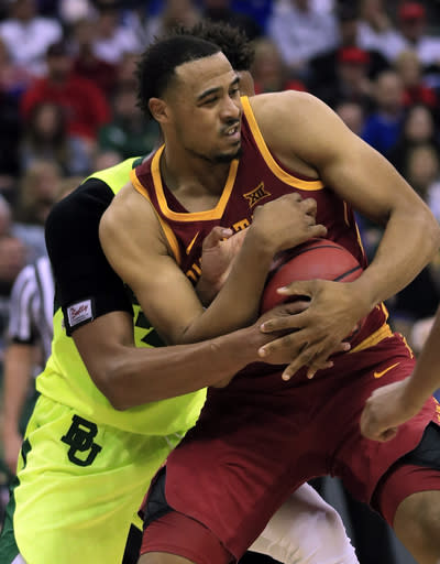 Iowa State guard Talen Horton-Tucker, front, is fouled by Baylor forward Freddie Gillespie, back, during the second half of an NCAA college basketball game in the quarterfinals of the Big 12 conference tournament in Kansas City, Mo., Thursday, March 14, 2019. Iowa State defeated Baylor 83-66. (AP Photo/Orlin Wagner)