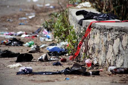 A view shows clothing and items scattered on the site where a cargo truck careened off a road and turned over, killing at least 25 migrants from Central America, in Francisco Sarabia, Chiapas state, Mexico March 8, 2019. REUTERS/Jacob Garcia