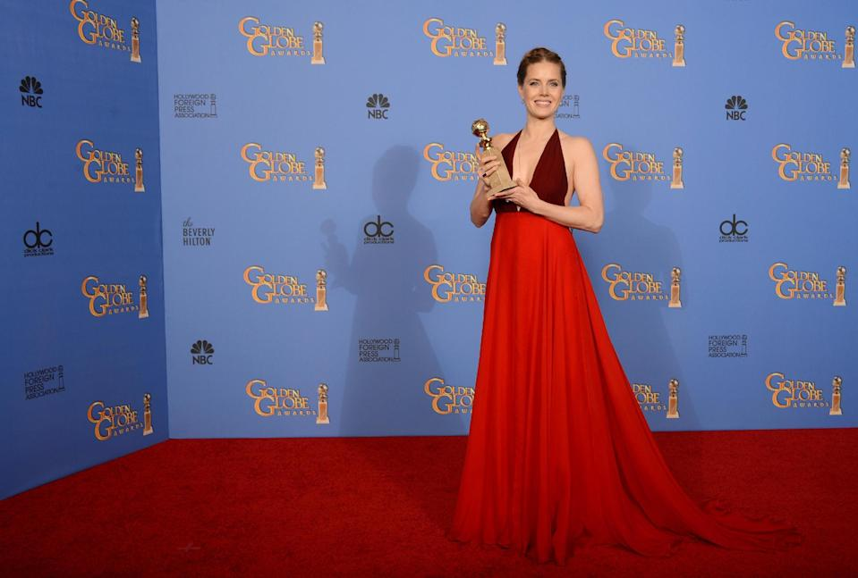 "Amy Adams poses in the press room with the award for best actress in a motion picture - comedy or musical for ""American Hustle"" at the 71st annual Golden Globe Awards at the Beverly Hilton Hotel on Sunday, Jan. 12, 2014, in Beverly Hills, Calif. (Photo by Jordan Strauss/Invision/AP)"