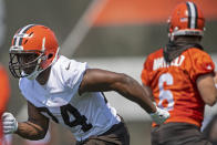 Cleveland Browns running back Nick Chubb (24) runs a pass route during NFL football practice in Berea, Ohio, Wednesday, July 28, 2021. (AP Photo/David Dermer)