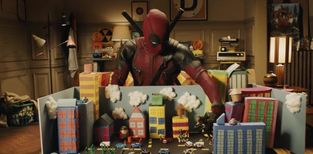 Deadpool plays with a Cable doll in new trailer. (Photo: 20th Century Fox)