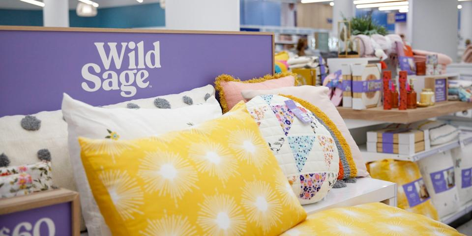 A bed with Wild Sage products.