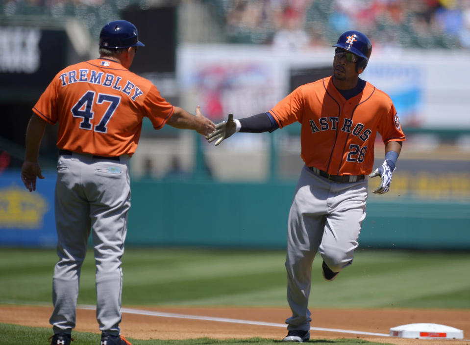 Houston Astros' L.J. Hoes, right, is congratulated by third base coach Dave Trembley after hitting a solo home run during the first inning of their baseball game against the Los Angeles Angels, Sunday, Aug. 18, 2013, in Anaheim, Calif. (AP Photo/Mark J. Terrill)
