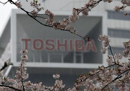 Toshiba stock listing status downgraded, deeper losses flagged