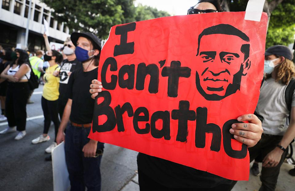 """<p>A protestor holds up a sign bearing some of George Floyd's last words: """"I can't breathe,"""" during a protest in Los Angeles in 2020.</p> (Getty Images)"""