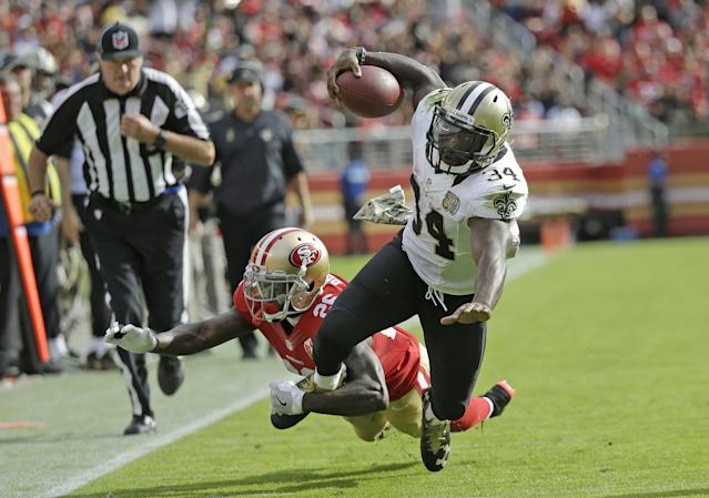 <p>New Orleans Saints running back Tim Hightower goes tumbling with ball while being stopped by San Francisco 49ers cornerback Tramaine Brock, left, during the first half of an NFL football game Sunday, Nov. 6, 2016, in Santa Clara, Calif. (AP Photo/Tony Avelar) </p>