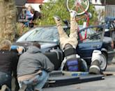 <p>A stuntman, playing a bicyclist, flips over a car door, while filming on location in Brooklyn.</p>