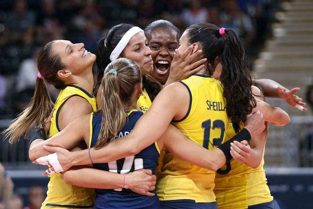 LONDON, ENGLAND - JULY 30:  Brazil player celebrate winning a point in the Women's Volleyball Preliminary match between the United States and Brazil on Day 3 of the London 2012 Olympic Games at Earls Court on July 30, 2012 in London, England.  (Photo by Elsa/Getty Images)