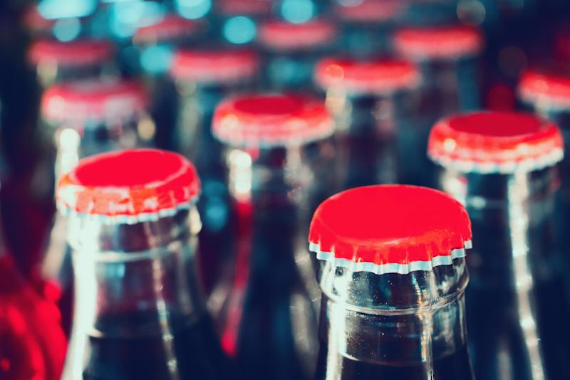 Close-up of numerous glass soda bottles.