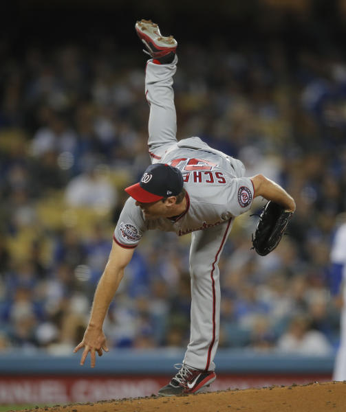 Washington Nationals starter Max Scherzer watches a pitch to a Los Angeles Dodgers batter during the third inning of a baseball game Friday, April 20, 2018, in Los Angeles. (AP Photo/Jae C. Hong)