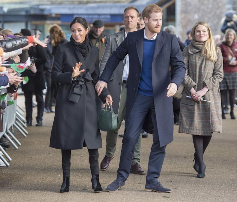 Amy Pickerill (right) with Prince Harry and Meghan Markle in Cardiff, Wales, on Jan. 18, 2008.