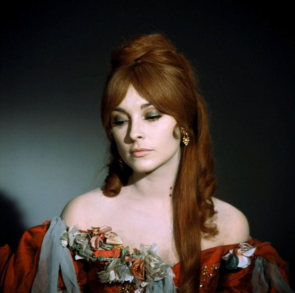<p>Sharon Tate wore a striking pair of large citrine pendant earrings in <em>The Fearless Vampire Killers</em>. The jewels looked striking against the auburn wig she wore for the role.  </p>