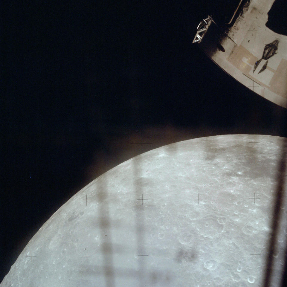 This April 1970 photo made available by NASA shows the moon through a window on the lunar module as the Apollo 13 crew heads back towards the Earth. (NASA via AP)