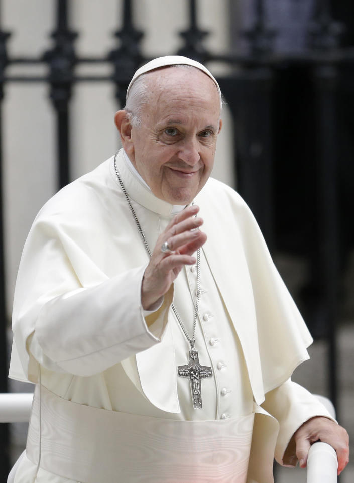 Pope Francis salutes the faithful as he leaves after visiting St Mary's Pro-Cathedral, in Dublin, Ireland, Saturday, Aug. 25, 2018. Pope Francis is on a two-day visit to Ireland. (AP Photo/Peter Morrison)