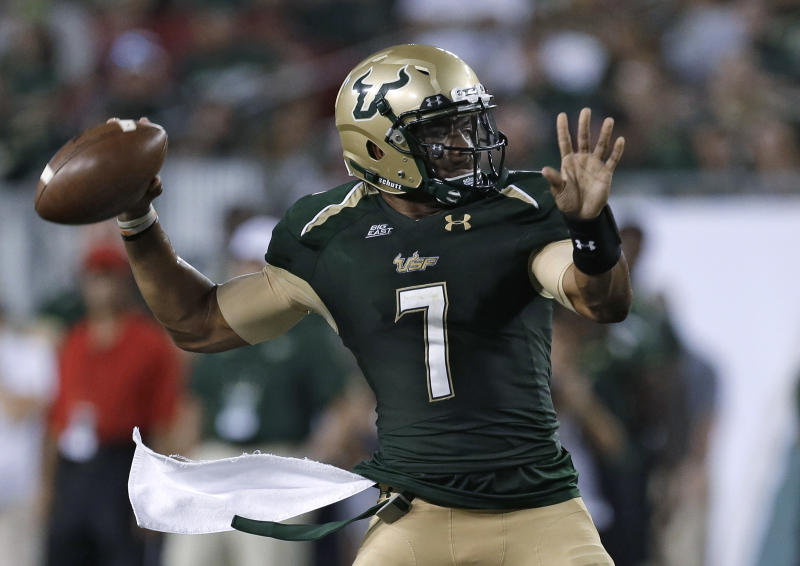 South Florida quarterback B.J. Daniels prepares to throw a pass against Rutgers during the first quarter of an NCAA college football game Thursday, Sept. 13, 2012, in Tampa, Fla. (AP Photo/Chris O'Meara)