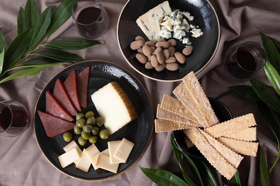 """<p>Indulge the cheese fans on your list with this curated collection of cave-aged Gruyère, Manchego, Hazen Blue, and other goodies that pair perfectly with red wine. (Monthly <a href=""""https://www.murrayscheese.com/monthly-clubs?promo_name=monthly_clubs&promo_id=monthly_clubs_clp&promo_position=side_banner&promo_creative=monthly_clubs_side_banner"""" rel=""""nofollow noopener"""" target=""""_blank"""" data-ylk=""""slk:cheese club subscriptions"""" class=""""link rapid-noclick-resp"""">cheese club subscriptions</a> also available.)</p> <p><strong><em>Buy Now: </em></strong><em>Murray's Cheese Red Wine Lover's Collection, </em><em>$95, <a href=""""https://www.murrayscheese.com/red-wine"""" rel=""""nofollow noopener"""" target=""""_blank"""" data-ylk=""""slk:murrayscheese.com"""" class=""""link rapid-noclick-resp"""">murrayscheese.com</a></em><em>.</em></p>"""