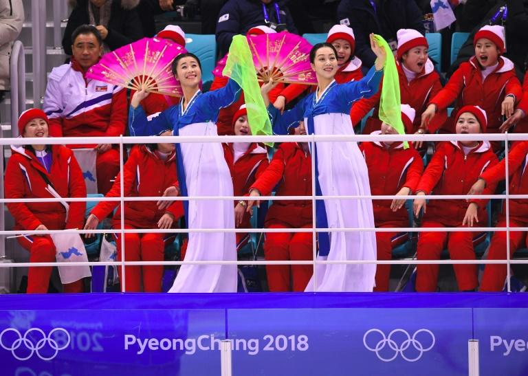 The cheerleaders are part of a charm offensive by Pyongyang aimed, analysts say, at easing the measures against it and trying to drive a wedge between Seoul and its protecting ally Washington