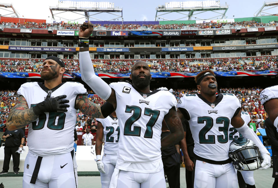 Chris Long, left, and Malcolm Jenkins, center, were among the Eagles players planning to skip the team's scheduled White House visit. (AP)