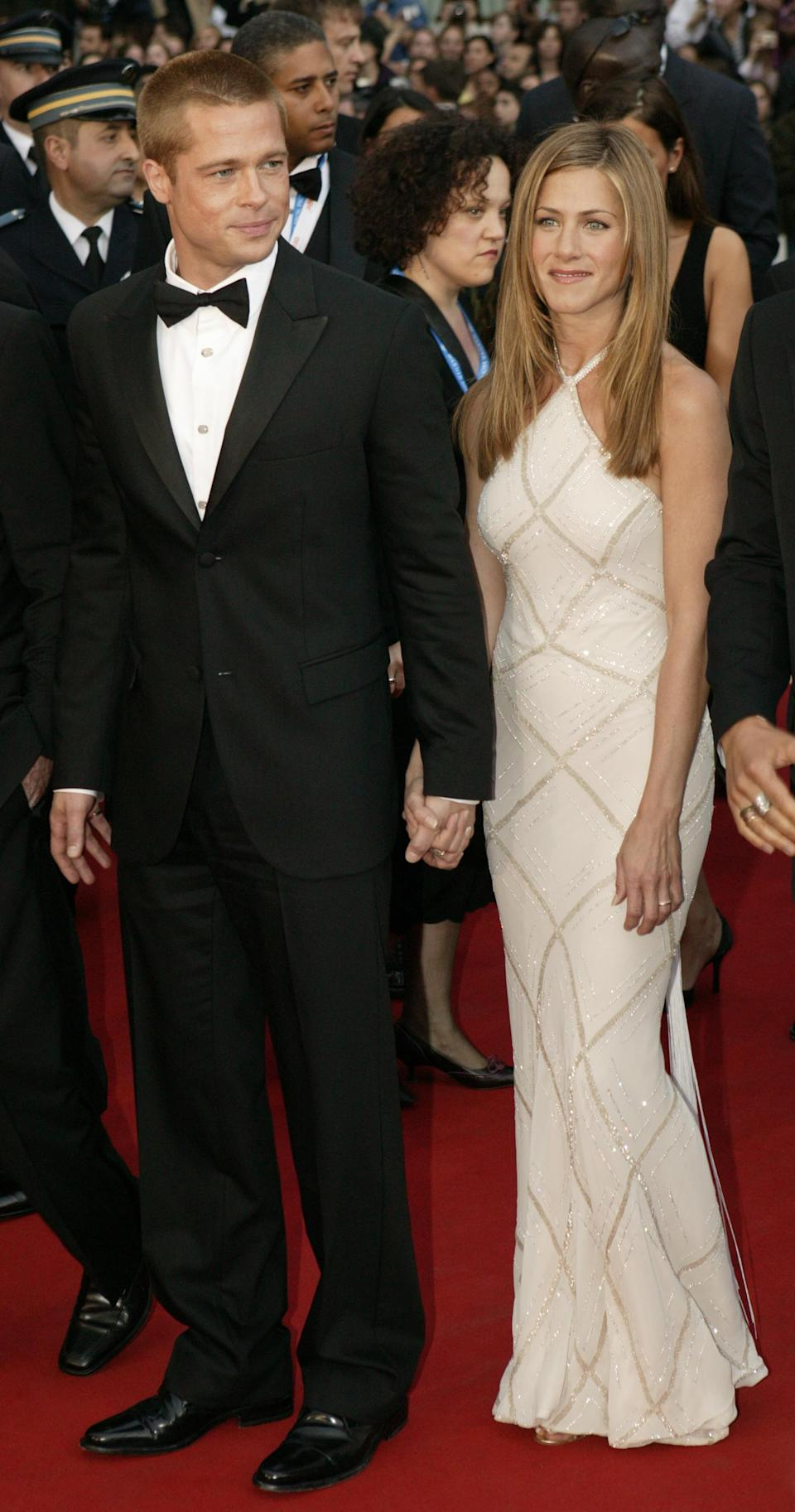 """All eyes were on Aniston and then-husband Brad Pitt at the glamorous Cannes premiere of """"Troy"""" in 2004. (Photo by Dave Hogan/Getty Images)"""