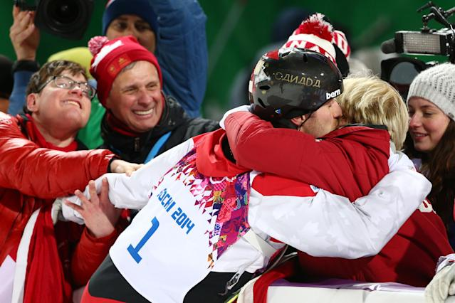 SOCHI, RUSSIA - FEBRUARY 10: Gold medalist Alex Bilodeau of Canada celebrates with his mother after the flower ceremony for the Men's Moguls Finals on day three of the Sochi 2014 Winter Olympics at Rosa Khutor Extreme Park on February 10, 2014 in Sochi, Russia. (Photo by Cameron Spencer/Getty Images)