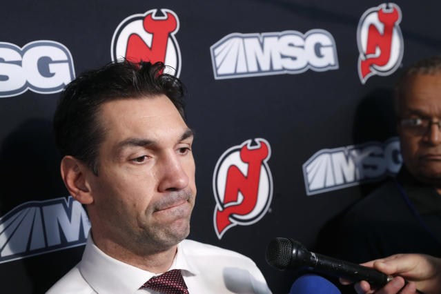 New Jersey Devils interim coach Alain Nasreddine speaks to the media before an NHL hockey game against the Vegas Golden Knights, Tuesday, Dec. 3, 2019, in Newark, N.J. Nasreddine was named interim head coach by Devils General Manager Ray Shero after the Devils fired head coach John Hynes earlier in the day. (AP Photo/Kathy Willens)