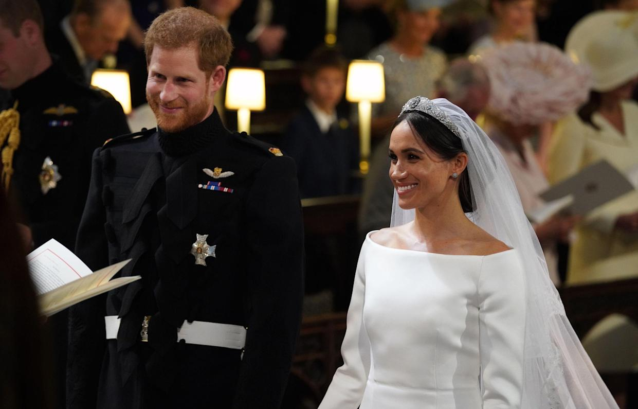 The Duchess of Sussex even tied the knot with her hair in a low wispy bun (tendrils and all) [Photo: Getty]