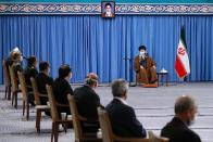 FILE - In this Oct. 24, 2020, file photo released by the official website of the office of the Iranian supreme leader, Supreme Leader Ayatollah Ali Khamenei, wearing a mask to protect against COVID-19, attends a meeting with National Corona Headquarters, in Tehran, Iran. As a new wave of coronavirus infections engulfed Iran this month, filling hospitals and driving up the death toll, the country's health minister gave a rare speech criticizing the government's powerlessness to enforce basic health measures. (Office of the Iranian Supreme Leader via AP, File)
