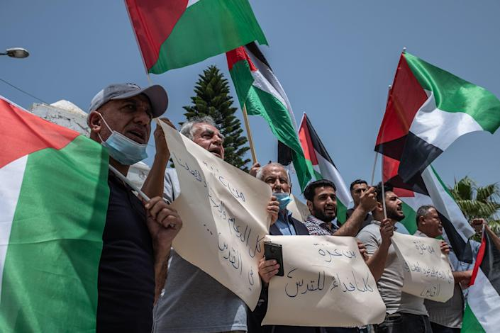 <p>Palestinians protest in Gaza following Israeli evictions in Jerusalem.</p> (Getty Images)