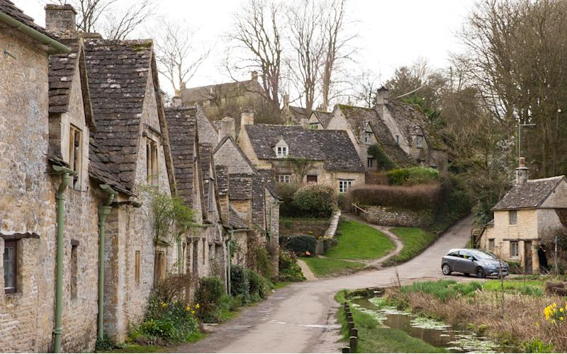 Peter Maddox's new grey car parked outside his home in Bibury - © SWNS.com