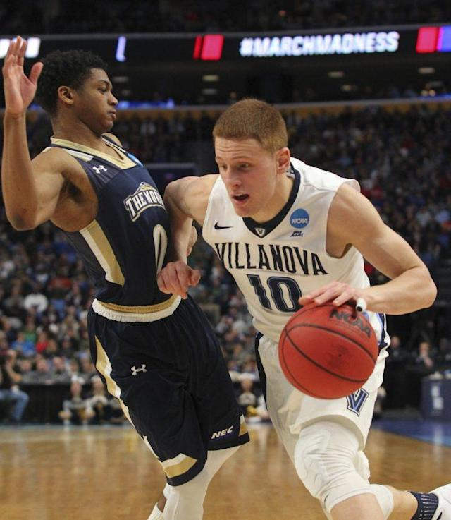 "Villanova guard <a class=""link rapid-noclick-resp"" href=""/ncaab/players/131427/"" data-ylk=""slk:Donte DiVincenzo"">Donte DiVincenzo</a> (10) drives to the basket against Mount St. Mary's guard <a class=""link rapid-noclick-resp"" href=""/ncaab/players/127407/"" data-ylk=""slk:Junior Robinson"">Junior Robinson</a> (0) during the second half of a first-round men's college basketball game in the NCAA Tournament, Thursday, March 16, 2017, in Buffalo, N.Y. Villanova won, 76-56. (AP Photo/Bill Wippert)"
