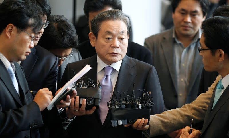 FILE PHOTO: Samsung Electronics chairman Lee Kun-hee answers reporters' questions upon his arrival at the company's headquarters in Seoul