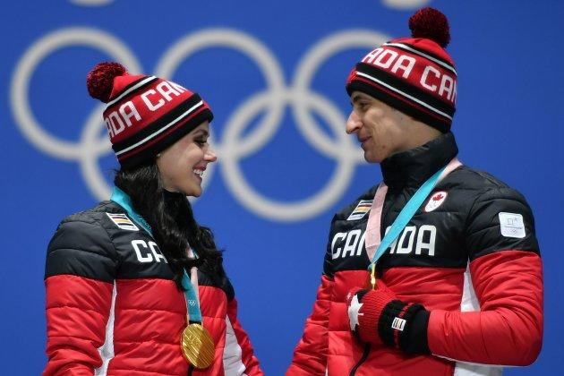 Canada's gold medallists Tessa Virtue and Scott Moir pose on the podium during the medal ceremony for the figure skating ice dance on February 20, 2018.