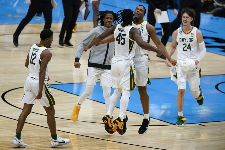 Baylor guard Davion Mitchell (45) celebrates with teammate guard Mark Vital after making a 3-point basket at the end of the first half of a men's Final Four NCAA college basketball tournament semifinal game against Houston, Saturday, April 3, 2021, at Lucas Oil Stadium in Indianapolis. (AP Photo/Michael Conroy)