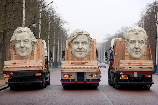 EDITORIAL USE ONLY Three 8 foot models of the heads of The Grand Tour presenters, Jeremy Clarkson, James May and Richard Hammond travel down The Mall in London on the back of flatbed trucks after travelling 30,000 miles across 3 continents.