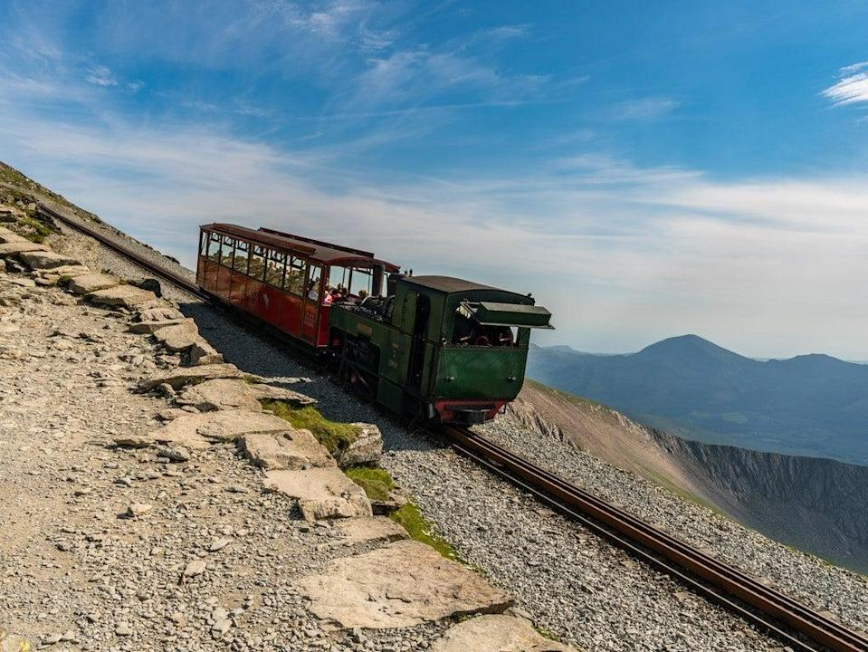 View from the Llanberis Path, with a train of the Snowdon Mountain Railway (Getty)