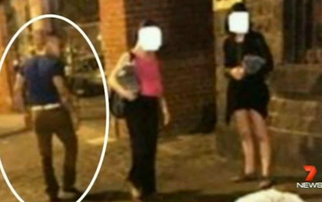 Two women thought to be the thug's friends watched on. Source: 7 News.