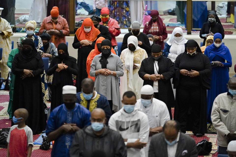 Worshippers perform an Eid al-Fitr prayer at the Masjidullah Mosque in Philadelphia, Thursday, May 13, 2021. Millions of Muslims across the world are marking a muted and gloomy holiday of Eid al-Fitr, the end of the fasting month of Ramadan - a usually joyous three-day celebration that has been significantly toned down as coronavirus cases soar. (AP Photo/Matt Rourke)