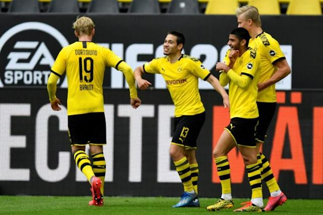 Dortmund players celebrate one of their goals against Schalke by bumping elbows (AFP Photo/Martin Meissner)