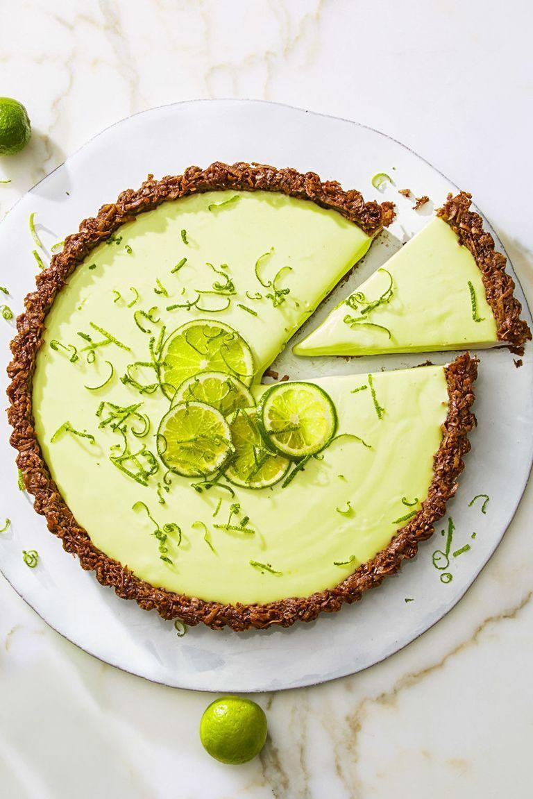 "<p>Freshen up after a hearty feast with this tangy tart, complete with gluten-free crust. </p><p><a class=""link rapid-noclick-resp"" href=""https://www.amazon.com/Rotating-Revolving-Turntable-Graduation-Anniversary/dp/B07GBRGXZ7?tag=syn-yahoo-20&ascsubtag=%5Bartid%7C10055.g.3262%5Bsrc%7Cyahoo-us"" rel=""nofollow noopener"" target=""_blank"" data-ylk=""slk:SHOP CAKE STANDS"">SHOP CAKE STANDS</a></p><p><em><a href=""https://www.goodhousekeeping.com/food-recipes/dessert/a43461/cocoa-nutty-lime-tart-recipe/"" rel=""nofollow noopener"" target=""_blank"" data-ylk=""slk:Get the recipe for Cocoa-Nutty Lime Tart »"" class=""link rapid-noclick-resp"">Get the recipe for Cocoa-Nutty Lime Tart »</a></em><br></p>"