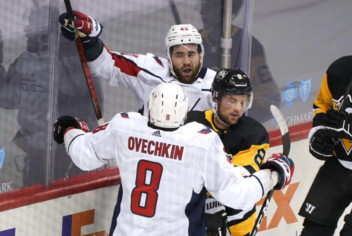 Washington Capitals' Tom Wilson (43) celebrates his first of two goals during the first period of the team's NHL hockey game against the Washington Capitals in Pittsburgh, Tuesday, Jan. 19, 2021. (AP Photo/Gene J. Puskar)
