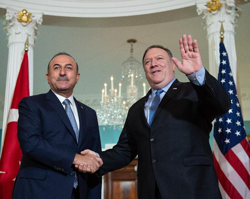 "Turkish Foreign Minister Mevlut Cavusoglu (L, pictured November 2018) said after a phone call with US Secretary of State Mike Pompeo that he finds ""correct his statement about the removal  of the elements that concern Turkey"""