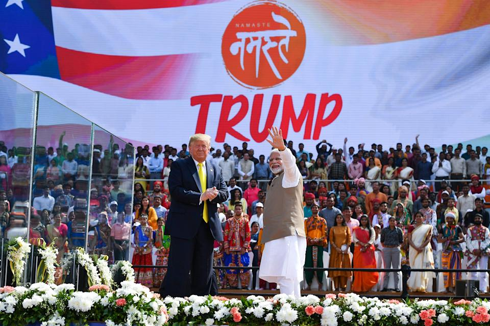 US President Donald Trump (L) looks on as India's Prime Minister Narendra Modi waves during 'Namaste Trump' rally at Sardar Patel Stadium in Motera, on the outskirts of Ahmedabad, on February 24, 2020. (Photo by Mandel NGAN / AFP) (Photo by MANDEL NGAN/AFP via Getty Images)