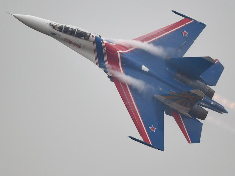 The Russian Airforce aerobatic team performs in their SU-27 jets: JOHANNES EISELE/AFP/Getty Images