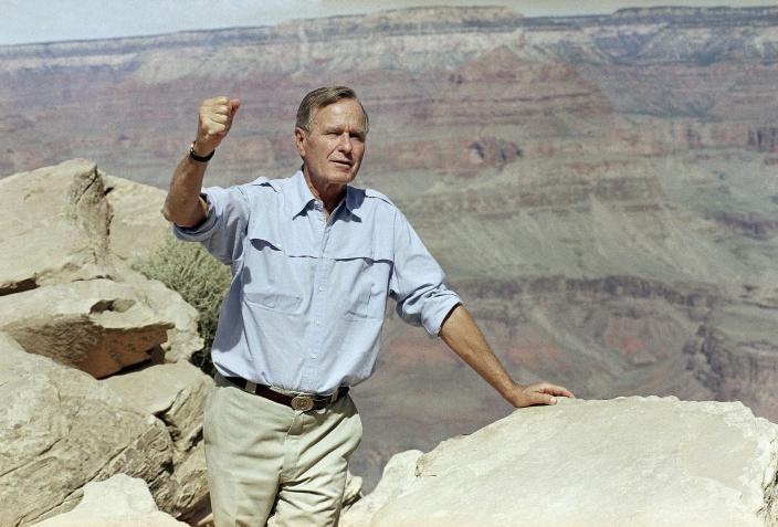 <p>President George H.W. Bush walks into the Grand Canyon on Kaibab Trail on Sept. 18, 1991, on a hike of about a mile to Ooh Aah Point on his half-day visit. (Photo: Greg Gibson/AP) </p>