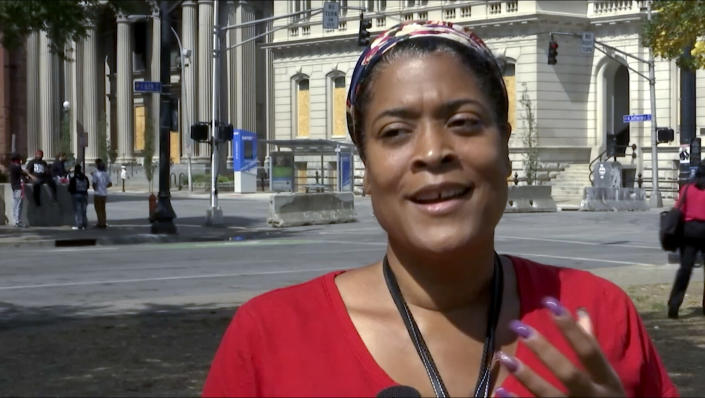 In this image made from video on Sept. 24, 2020, Chea Woolfolk speaks to a reporter on the streets of Louisville, Ky. Woolfolk, is one of many demanding justice for Breonna Taylor, the 26-year-old emergency medical technician shot and killed by police when they burst into her house in the middle of the night in a botched raid. (AP Photo/Mike Householder)